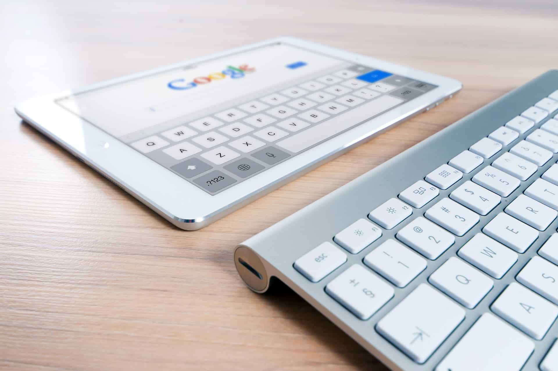 Key board and tablet with google search engine open - seo trends 2019