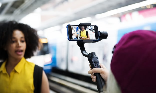 Young adults vlogging - sussex new media - benefits of youtube for your business